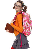 Portrait of schoolgirl with books and bag in glasses — Stock Photo
