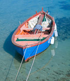 Coloured rowboat in clear sea. — Stock Photo
