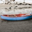 Fishing boat on shore of sandy beach. — ストック写真