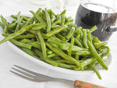 Green Beans Salad with fork at Dinner. — Stock Photo