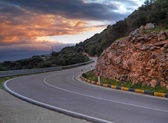 Mountain road at sunset. — Stock Photo