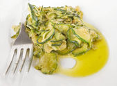 Courgette on white dish. — Stock Photo