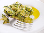 Courgettes on white dish. — Stock Photo