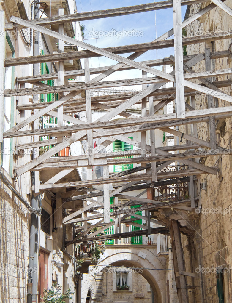 Alley in Molfetta Oldtown with reinforced scaffolding. Apulia.  Stock Photo #3040706