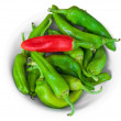 Royalty-Free Stock Photo: Chili peppers on white dish.