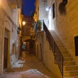 Alleyway at dusk. Giovinazzo. Apulia. — Stock Photo