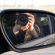 Driving mirror with photographer. — Stock Photo
