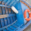 Royalty-Free Stock Photo: Overturned Blue Boat.