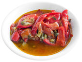 Stewed peppers on white dish. — Stock Photo
