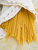 Spaghetti wrapped in napkin. — Stock Photo