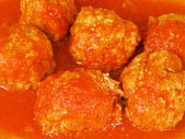 Meatballs in tomato sauce on white dish. — Stock Photo