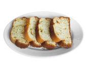 梅花在白盘子里的蛋糕. — 图库照片