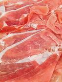 Closeup of raw ham sliced. — Stock Photo