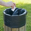 Hand throwing paper in litterbin. — Stock Photo #3182430