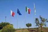 Flags on blue sky. — Stock Photo