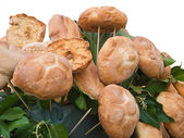 Bread rolls and leaves. — Stock Photo