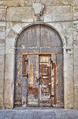 Wooden crumbling door. — Stock Photo