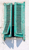 Crumbling green shutter. — Stock Photo