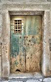 Crumbling wooden door. — Stock Photo