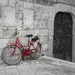 Red bicycle leaning against wall. — Stock Photo