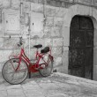 Red bicycle leaning against wall. — Stock Photo #3425516