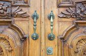 Closeup of brass handle of allwood door. — Stock Photo