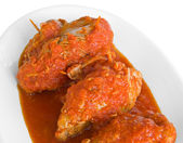 Meat roulade in tomato sauce on white dish. — Stock Photo