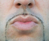 Close up of a man lips sending a kiss. — Stock fotografie