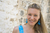 Smiling woman with turquoise earrings. — Stock Photo