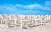 White chair group on blue sky. — Foto Stock
