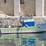 Trawler at Monopoli seaport. Apulia. — Stock Photo