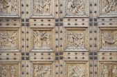 Wooden portal of St. Croce Church. Bastia Umbra. Umbria. — Stock Photo