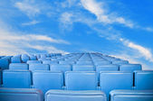 Blue armchairs group on blue sky. — Stock Photo