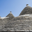 Trulli. Conical roofs. Alberobello. Apulia. — Stock Photo #3709508