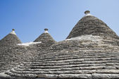 Trulli. Conical roofs. Alberobello. Apulia. — Stock Photo