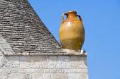 Close up of a terracotta water jug. Alberobello. Apulia. — Stock Photo