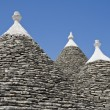 Trulli. Conical roofs. Alberobello. Apulia. — Stock Photo #3718142