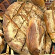 Sourdough breads in wicker basket. - Stock Photo