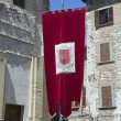 Red drape. Gubbio. Umbria. — Stock Photo