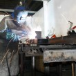 Labourer arc welding — Stock Photo
