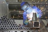 Labourer arc welding — Stock Photo