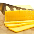 Stock Photo: Slicing Gouda