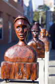 Carved wooden heads — Stock Photo