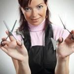 Beautiful hairdresser with scissors — Stock Photo