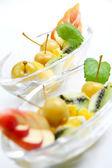 Delicious fresh fruits as dessert — Stock Photo