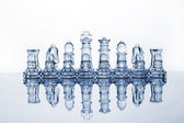 Glass chess pieces (toned in blue) — Stock Photo