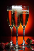 Glass of champagne with strawberry — Stock Photo