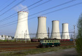 Cooling towers and locomotive — Stock Photo