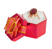 Gold ring with big ruby in gift box — Stock Photo