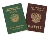 Uzbekistan and Russian passports — Stock Photo